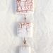Pendentif craquelé blanc et cuivre 4 carrés