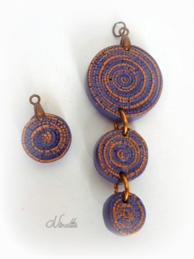 Pendentif 3 spirales violet patiné cuivre.JPG